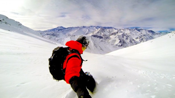Freestyle snowboarding by Travis Rice in the Andes Mountains