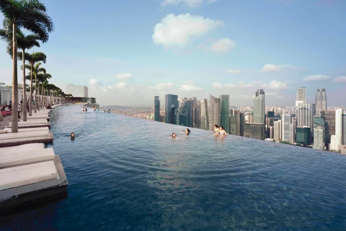 Marina Bay Sands rooftop pool is one of the most amazing swimming pools in the world.