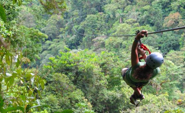 Image presents zip lining in Costa Rica, as a perfect place for a true adventurous spirit.