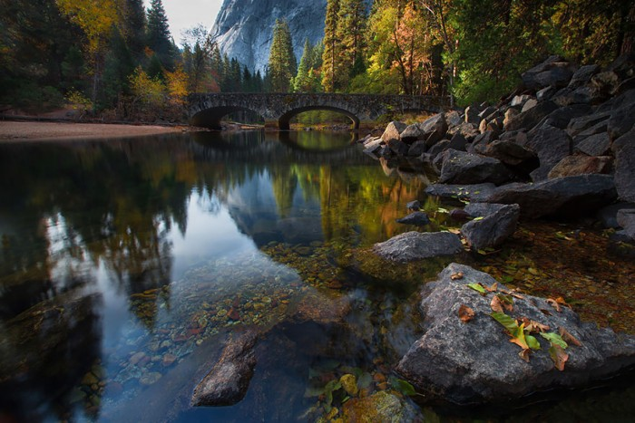 Bridge across the Merced River in Yosemite, USA is one of the World's most magical old bridges