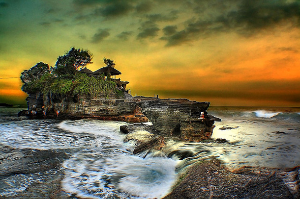 Tanah lot Temple in Bali is the one of the best spots to watch spectacular sunsets.