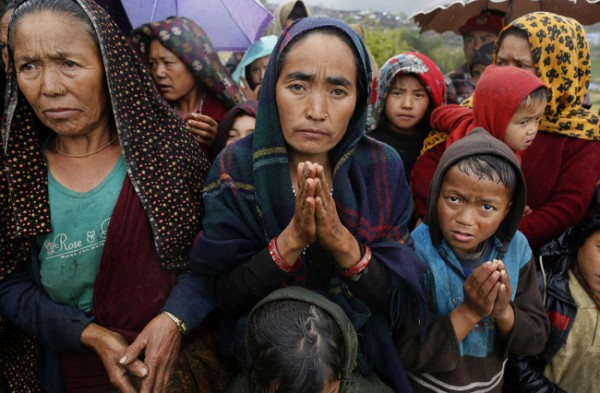 People plead for help after a massive Nepal earthquake.