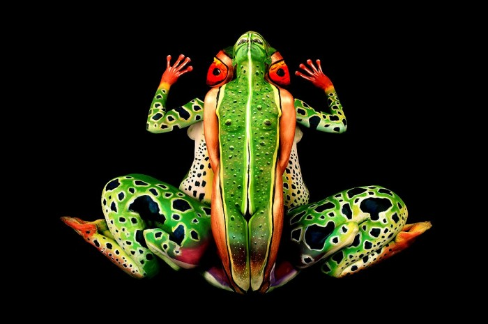 Full body painting create a perfect illusion of a colorful frog.