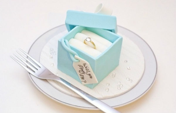 One of the most unique marriage proposal ideas is putting your ring into a cake.
