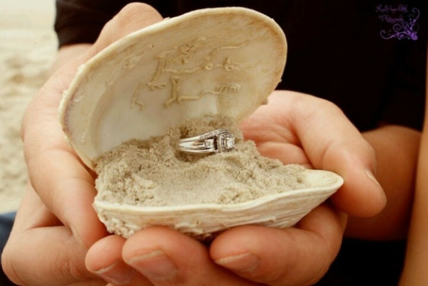 You want to propose your girlfriend! Think of something unique and special, like putting a ring into a shell.