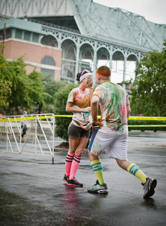 Asking your girl to marry you after a 5 k color run is one of the most unique marriage proposal ideas.