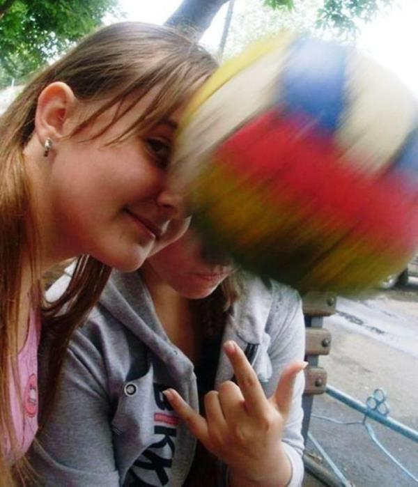 perfectly timed photos, a ball hitting a girl's face