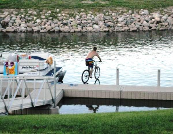 perfectly timed photos, a man cycling on water