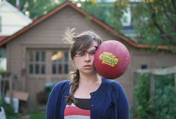 photos taken at just the right moment - a ball hitting a girl's face
