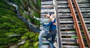 thrill-seekers-couple-lying-on-a-railroad-track-washington