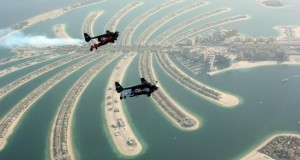 Watch two men fly over Dubai with jetpacks, Yves Rossy and Vince Reffet.