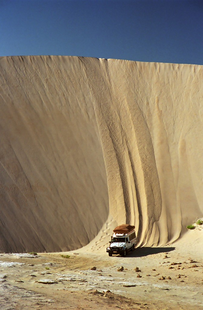 A man who is not afraid of heights drives down a sand dune in Lucky Bay in Australia.