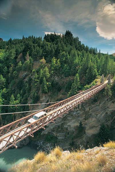 A man not afraid of heights drives his car across the Skippers bridge in New Zealand.