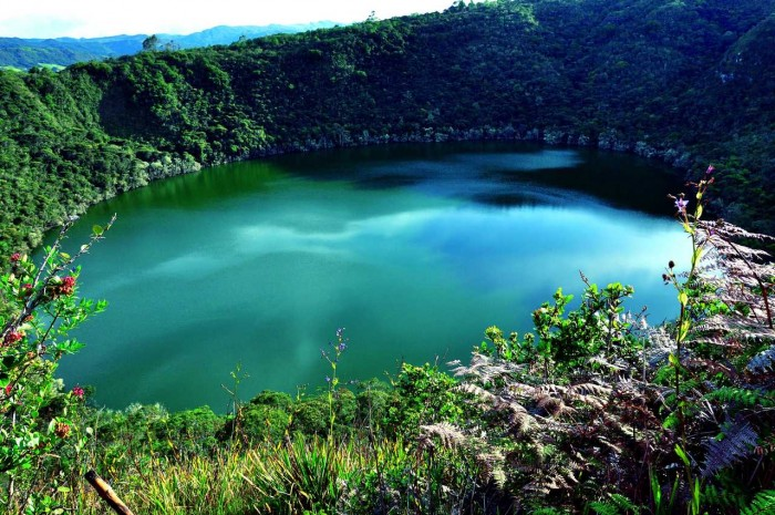 One of the most incredible crater lakes on earth is Lake Guatavita in Colombia.