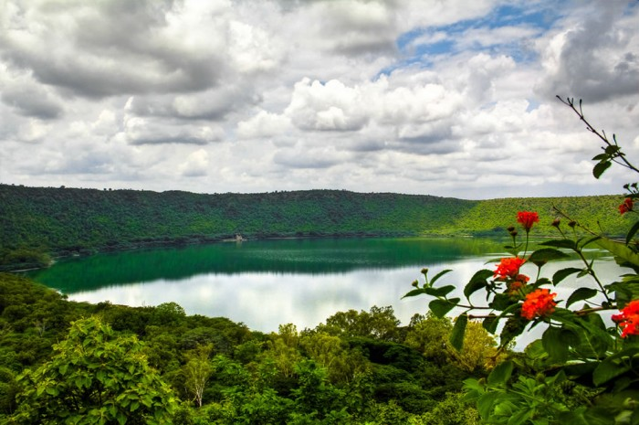 One of the most incredible crater lakes on earth is Lonar crater lake in India.
