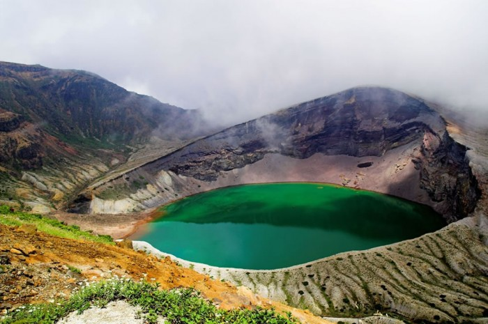 Okama lake in Japan is one of the most incredible crater lakes on earth.