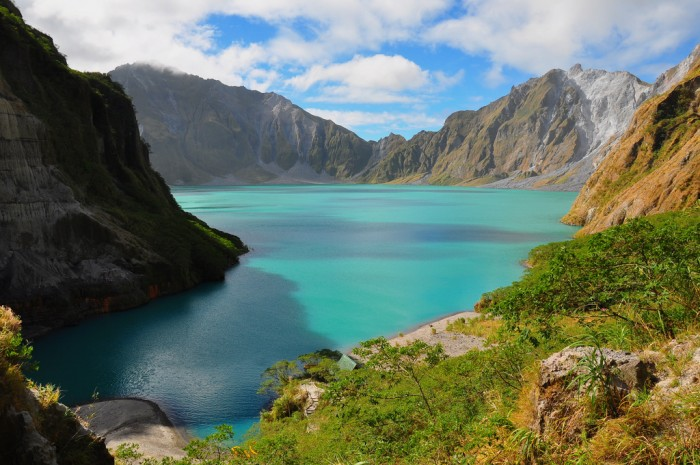lake Pinatubo in the Philippines is one of the most incredible crater lakes on earth.