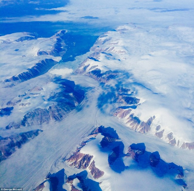 Impressive airplane window seat pictures above the Arctic Circle that will blow your