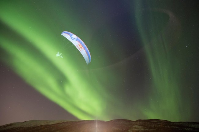 Breathtaking paragliding through Aurora Borealis in Norway by Horacio Llorens.