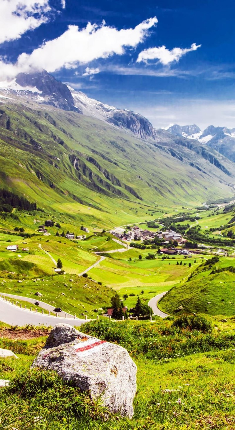 Mountain road in Swiss Alps Valley  is one of the roads you need to drive in your lifetime.