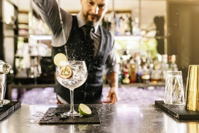 One of the 10 best travel jobs in the world is to work as a bartender.