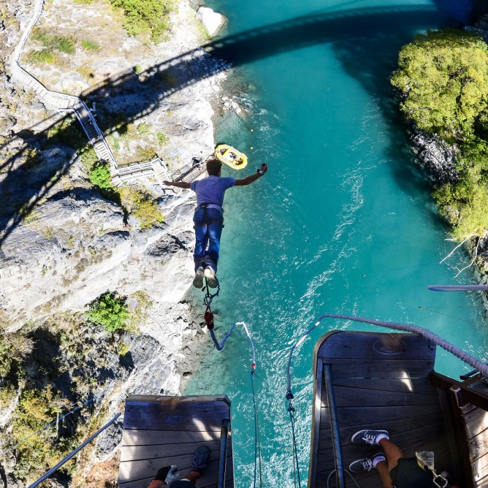 On his trip around New Zealand, he did a bungee jumping to make his adventure more exciting.