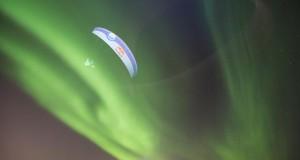 Breathtaking paragliding through Aurora Borealis in Norway by Horacio Llorens.