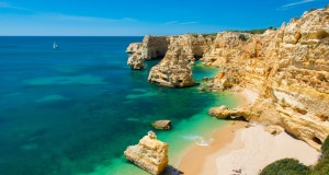 Best beaches to visit this summer. We suggest you Praia Dona Ana in Portugal.